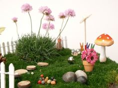Magical kid-made FAIRY GARDEN wit stepping stones, moss and toadstools from The Magic Onions Blog and FairyGardens.com