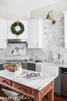 This post is brought to you by utter, total, and complete relief… after two and a half months of plastic, construction, take out, and dust, I'm thrilled to share with you our new, classic yet modern kitchen all decked out for Christmas.