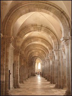Unit 2  Romanesque-This shows the diaphragm arches that were popular in the Romanesque time period. We can also see the groin vaulting of the ceiling and the smaller columns which are representative of the era. I love the monotone color and simple features of this church. Beautiful!