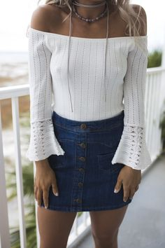 - A denim mini skirt features a button down front, two front pockets, a zipper back, and no lining - Material is Cotton and Spandex - Model Bailey is 5'2 wearing a small Width Length WaistBand Small 1