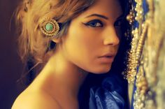 ring or costume jewelry in hair. Ali Xeeshan