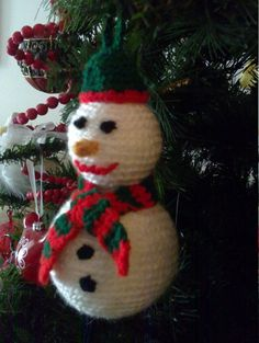 This hand-knitted snowman is guaranteed to make a wonderful addition to your Christmas tree or/and a cute Christmas gift!   Size: 15 centimeters (5.9 inches) Accessories available in additional colours upon request   Knitting is my passion and Christmas my favourite holiday. I hope you like my first attempt at sharing my hand-knit Christmas ornaments