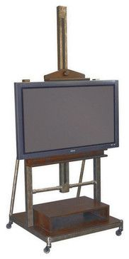 """Steampunk style adjustable artist's easel repurposed to hold up to a 50"""" flat-screen TV.  Universal mounting plate. Sometimes, sophistication comes in the most simple of designs. """"Structure"""" from Hammary.    Adjustable height easel Removable Shelf W24.5"""" x D16"""" x H5"""""""