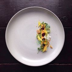 """This Guy is Plating Junk Food Like High End Cuisine and Its Awesome - """"I call this dish 'Bugs On a Stick' because the craisins are the 'bugs' and the cheese whiz/celery is the stick. Also celery soda caviar, graham cracker soil, canola oil powder and kale shreds."""