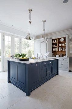 grey and navy kitchen by Tom Howley | Featured on Blue Tea Kitchen inspiration
