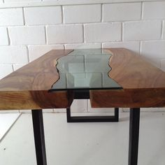 Live edge Acacia wood dining table with glass by IndiaExotica