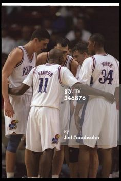 Guard Jacque Vaughn of the Kansas Jayhawks confers…(Eric's favorite player), ...also see Paul Pierce to his right.