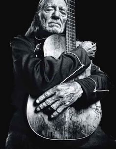 Willie Nelson.... Not sure aging gracefully would be the way I would describe Willie... but love his music... and this photograph of him... photographer?