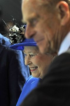 Queen Elizabeth II and Prince Philip, Duke of Edinburgh take in swimming at the Aquatic Centre on Day 1 of the Olympics.