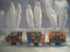 Bunny treat boxes are made from tiny plastic containers found at the dollar store. Add chenille stem ears and google eyes. Great for a school party. #Treat