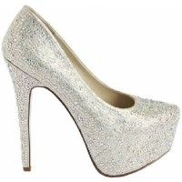 The Betsey Johnson Wish Wedding Shoes area stunning work of art. The over the top platform pump design is fully encrusted in glittering champagn