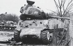 A pair of M4A3's of the 12th Armored Division following the fighting in Herrlisheim. Most of the 43rd Tank Battalion was knocked out in this battle