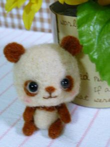 Kawaii style little brown needle felted panda. This is a really cute version of a panda. I like that it is chocolate brown instead of black. The body proportions make him even cuter than you think.