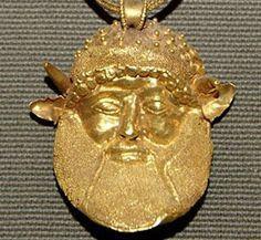 etruscan gold pendant - horned face