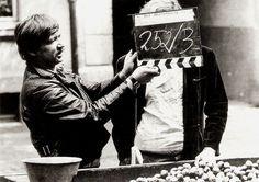 https://flic.kr/p/T2jgw2 | Rainer Werner Fassbinder, shooting Händler der vier Jahreszeiten (1971) | German postcard by Verlag Hias Schaschko, München (Munich), no. 209. Photo: Fassbinder during the shooting of Händler der vier Jahreszeiten/The Merchant of Four Seasons (1971), then still called Der Obsthändler/The Grocer.  Rainer Werner Fassbinder (1945-1982) was a German film director, screenwriter, film producer and actor. Fassbinder was part of the New German Cinema movement. Starting at…