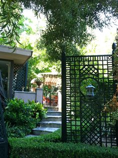 A spectacular Accents of France lattice announces the entrance of designer Joe Ruggiero's dining terrace.