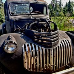 Old tires of the north shore, rusted old truck.   photo by d. malner