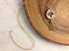 "Hand-made clear beaded chain with druzy & tassel necklace by local Louisville artist, W&M Custom Jewelry. A tassel says it all! Can't go wrong for an elegant night out on the town! Chain is 38"" is length."