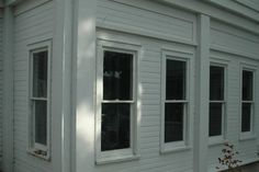 Original double hung windows on all levels.