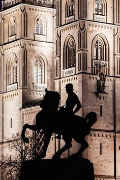 The Gothic twin towers of the Grossmunster cathedral with the silhouette of the statue of Mayor Hans Waldmann on horseback, Zurich, Switzerland. Vatican City, Switzerland, Cathedral, Medieval, Gothic, National Parks, Old Things, Statue, Architecture