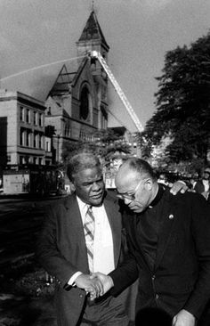 Mayor Harold Washington with Cardinal Clements as Holy Angels burns in the background  1986