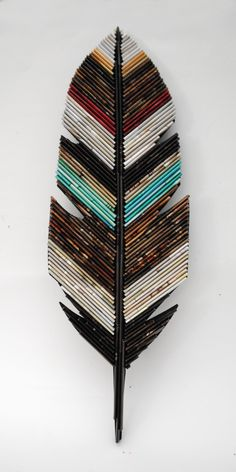 FEATHER- neutral colored wall art - made from recycled magazines, unique, home decor, interior design, unique, handmade, native, natural by colorstorydesigns on Etsy https://www.etsy.com/listing/476497310/feather-neutral-colored-wall-art-made