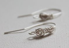 How to make your own spiral earwire - a nice little detail for when you need something a bit unique to finish off the design.  Simple but elegant.