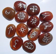 Carnelian  Runes. From Castastone,com. In stones & crystals most have smooth surfaces, whether it is a tumbled or natural formation. A mineral that is just painted or etched wears away with minimal use. To engrave the stone, however, makes a deeper groove that holds and grasps the paint or leafing, making its longevity washable and durable.