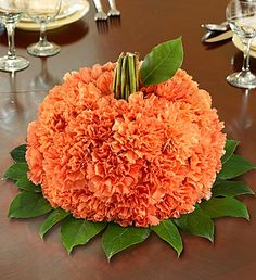Flower Pumpkin, i could make this with artificial flowers and reuse for decoration every year!