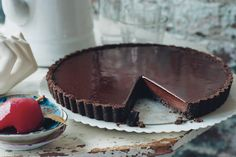 A triple layer of crumbly crust, a truffle-like interior, and an almost patent-leather-shiny glaze make this tart the chicest take on chocolate we've come across in a long time.