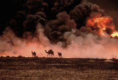 Burning oil wells in Kuwait, 1991.  Photo credit to Steve McCurry, who took MANY amazing shots during that conflict.