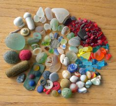 This listing consists of: 175+ pieces of odds & ends of beach sea glass etc. This includes Red, Turquoise, Orange, UV Yellow, Purple and Teal Roughs. (This means that every piece has some sort of chip, ding, flaw) There is a gorgeous red that is bigger than a quarter but it has a chip on one side. I showed a close-up photo with light shinning in on it and the shadow at the top is the chip on the other side. Also included in this lot are some very unique marble parts, beads, buttons, stopper…