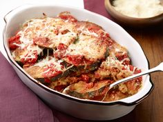 Gluten-Free Eggplant Parmesan : An Italian favorite gets a gluten-free makeover thanks to almond meal. Cleanup is also easier: Instead of frying in a skillet, bake the nut-crusted eggplant on a rack until it's golden brown.