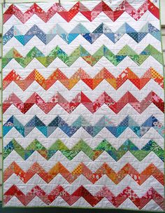 Prettiest zig zag quilt!    Maybe this could be Shark's teeth?