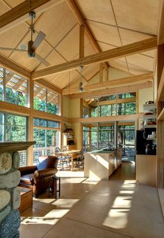 This living space is a generous height that extends to the porch. Note the translucent roofing that extends beyond the glass wall at left; this hints at what the porch has to offer.  A space to enjoy the outdoors that is bugfree is an important part of any real estate design. Click on pin to see how Pinterest Pro uses mapping.