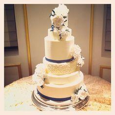An elegant wedding cake at the St. Regis. Congratulations Kathryn and Faraz! Photo by Sugar Flower Cake Shop. www.sugarflowercakeshop.com