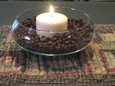 Coffee beans warmed by vanilla candle