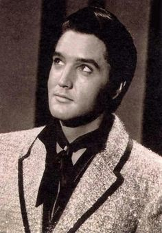 Elvis smiling - listening to God talk to him.....maybe.