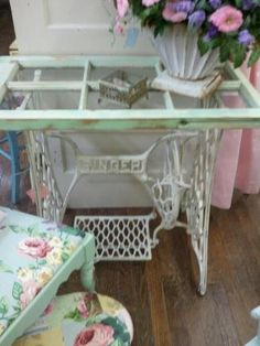 Singer sewing machine base with old window for shelf and vintage fabrics