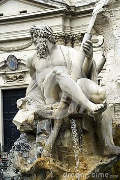 Details of an artistic stone sculpture in a fountain in the Piazza Navone, Rome, Italy.