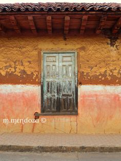 Old weathered adobe house & wooden window - Santa Ines, Michoacan Mexico