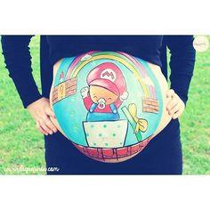 ¿A quién no le encanta Súper Mario?  A estos papis les gusta tanto que decidieron que sería un dibujo muy divertido para pintar su barriguita.  #laquepinta #bellypaint #bellypainting #bodypaintingembarazadas #bellyart #embarazada #embarazo #pregnant #pregnancy #regalooriginal #rercuerdoembarazo #fotosembarazo #supermario #colorful #love #tbt #ootd #instalike #instamakeup #makeupartist #barcelona #followme #followart #cute #happy  Más en www.laquepinta.com  Info@laquepinta.com