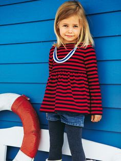 Stripes are such a great fabric for tops! This little girl's tunic is so cute and can even be worn year-round.