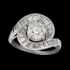 A diamond and platinum ring  centering an old European-cut diamond weighing approximately: 1.30 carats; in a swirled baguette-cut diamond surround; total remaining diamond weight approximately: 1.00 carat.