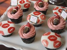 Such a cute idea. Use food colouring and a stamp to do lipstick kisses on icing.