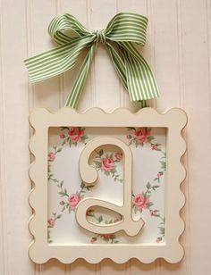 Frame a lowercase letter.  ribbon hanger