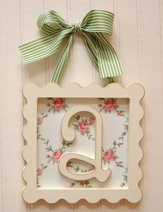 framed wooden letter