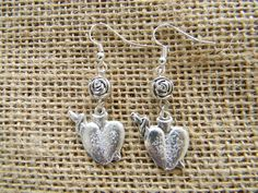 Silver Speared Heart Milagro Earrings with Silver Plated Rose Bead #milagro #milagros #spirit #christian #catholic #religious #jewish #blessing #altars #altar #miracle #charm #charmed #blessed #divine #mexico #saints #mexican #sale #gift #custom #folk #art #handmade #artifact #faith #style #shop #protection #custom #cool #god #cross #prayer #chic #fashion #jewelry #silver #necklace   Segundo Milagro  For more information, contact:  gringagordon@gmail.com