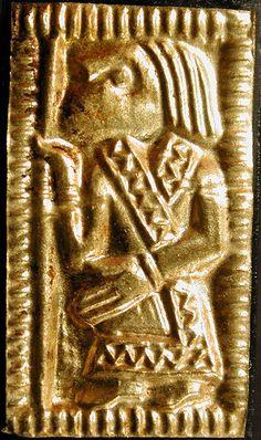 "Viking era thin gold plate ""guldgubbe"" portraying a man with a wrap-style jacket"