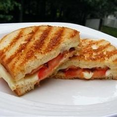 """Tomato Bacon Grilled Cheese I """"I was trying to think of something to cook for my two girls and I found this recipe. It was very good. I loved the taste and it gives grilled cheese sandwiches a different twist."""""""